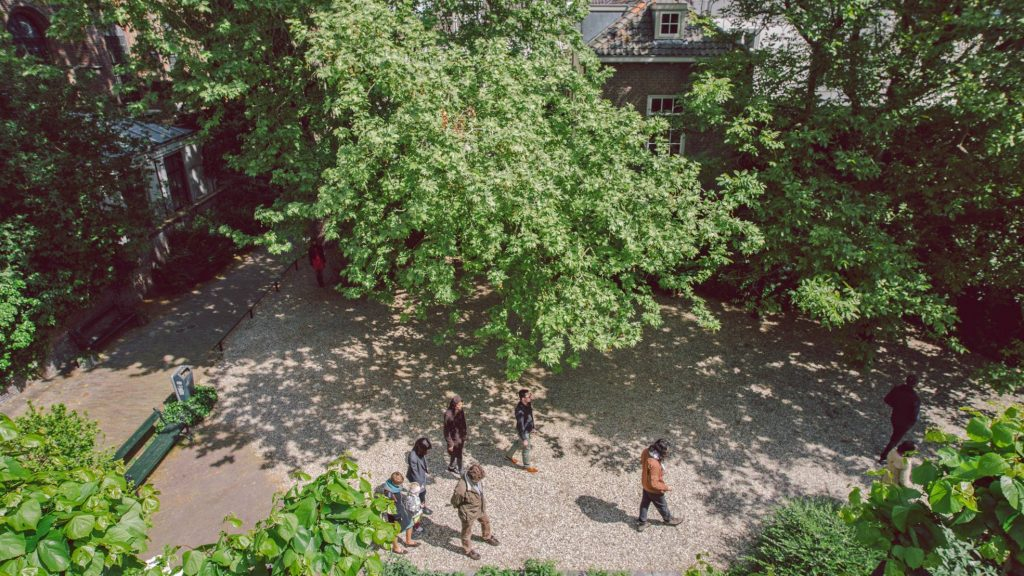 Image: Ienke Kastelein, Very, Very Slow Walk in the Footsteps of Ursula, 2014. Performance as part of the exhibition New Habits by Casco Art Institute: Working for the Commons in the Abraham Dolehof garden. Photo: Niels Molenaar.